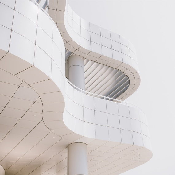 Curved white marbled facade of a modernist building